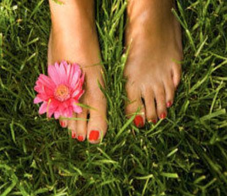 feet in grass